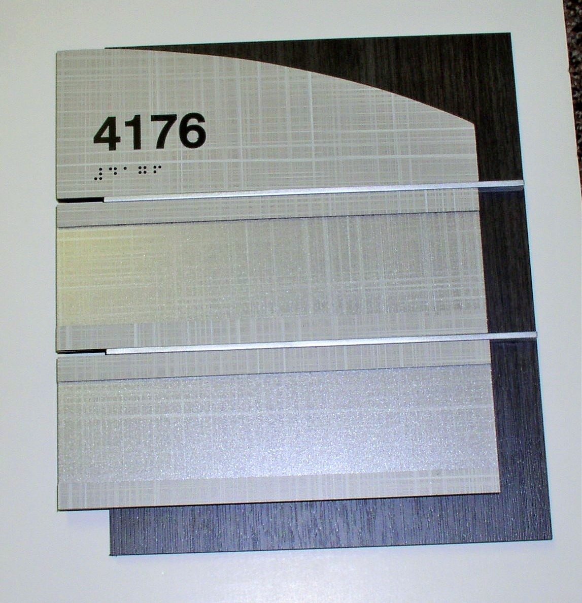 Window sign with laminate materials
